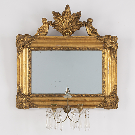 A late 19th century mirror wall sconce.
