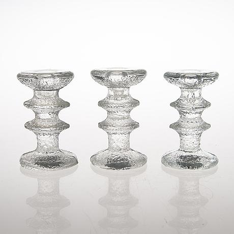 "Timo sarpaneva, a 12-piece set of ""festivo"" glass candlesticks for iittala."