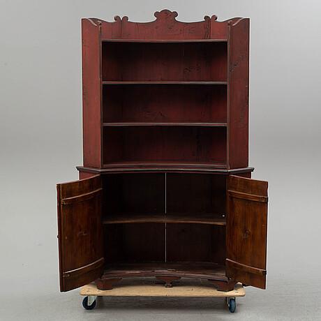 A 19th century corner cupboard.