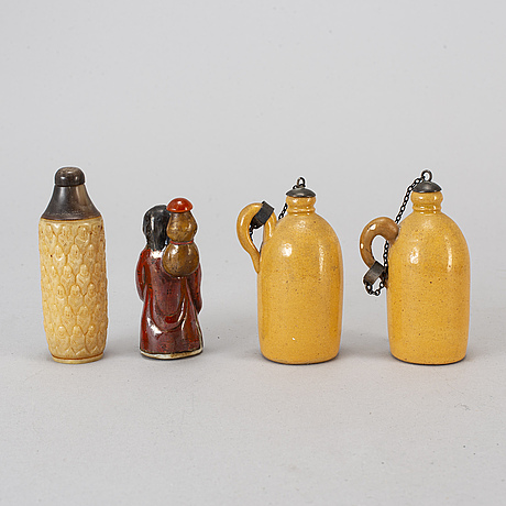Four chinese snuff bottles and a book, 20th century.