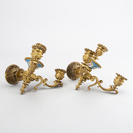 A pair of french neo louis xvi-style sconces.
