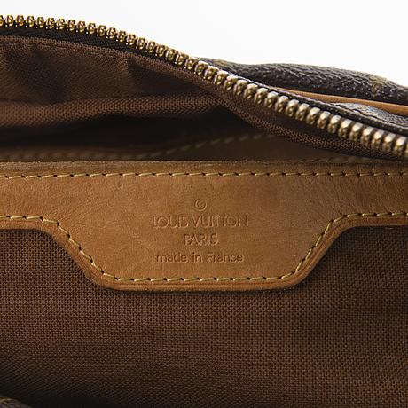 Louis vuitton monogram carryall bag.