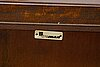 A mid 20th century cupboard. signed with label for treman.