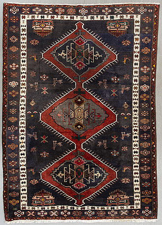 An old probably kazak carpet ca 305 x 213 cm.
