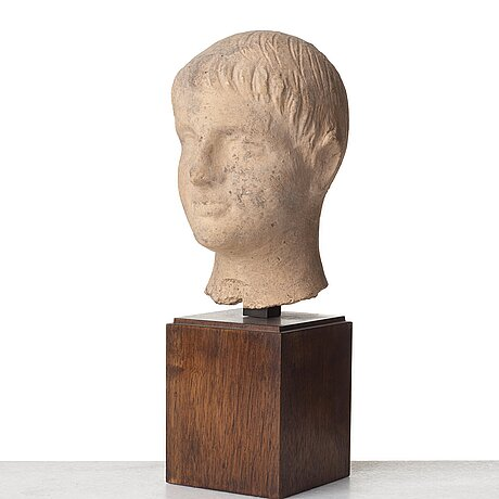 A terracotta sculpture of a young man, probably, 3rd century b.c, etruscan.