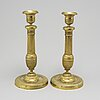 A pair of empire candle sticks, early 19th century.