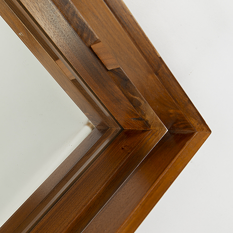 A second half of the 20th century teak framed mirror.