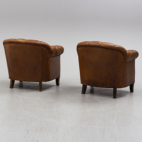 A pair of armchairs from the first half of the 20th century.