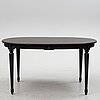 A gustavian style dining table from the second half of the 20th century.