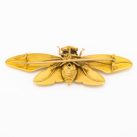 A 18k gold brooch marked guiraud, nimes. late 19th century.