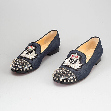Christian louboutin, a pair of denim and studs loafers, size 39 1/2.