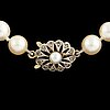 Cultured pearl necklace, clasp 18k gold with pearl.