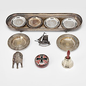 103. A table-bell, tray, ash-trays, snuff box, clip and a miniature-ship, silver plated and brass. 20th century.