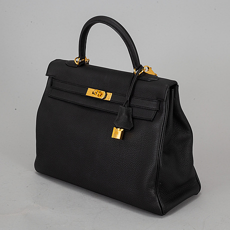 HermÈs, a 'kelly 35' black leather bag.