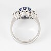 Brilliant-cut diamond and oval faceted sapphire ring.