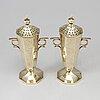 A pair of sterling silver potpourri vases, goldsmiths & silversmiths co ltd, london 1904.