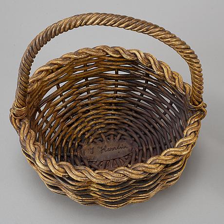 Ingrid herrlin, a ceramic sculpture in the shape of a basket with nine apples, signed.
