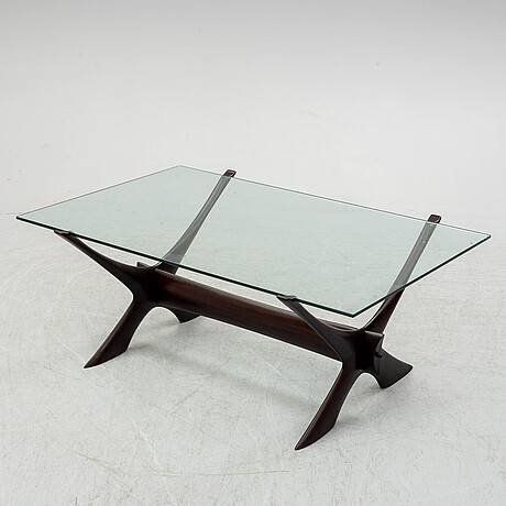 A glass top coffee table by fredrik schriever abeln.
