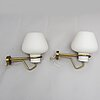 A pair of glass and brass asea wall lights from the mid 20th century.