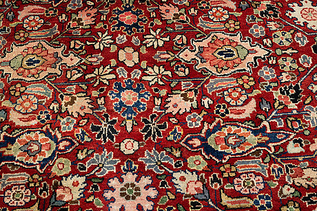 A carpet, semi-antique, sarouk, ca 406 x 302 cm.
