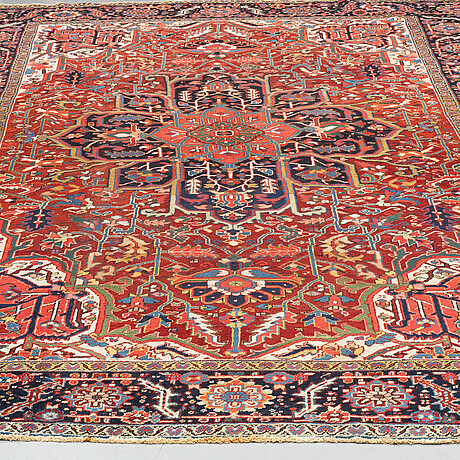 A carpet, semi-antique heriz, 383 x 256 cm.