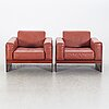 A pair of armchairs by tito agnioli for matteo grassi, second hal of the 20th century.