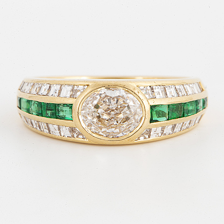 Oval-cut diamond ca 0,80 ct and carré-cut emerald and diamond ring, fasano italy.