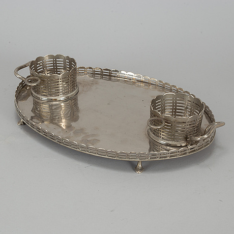 A silver plate centerpiece.