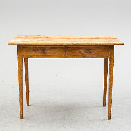 A late 19th century pine writing desk.
