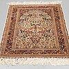 A chinese silk carpet, ca 193 x 95 cm.