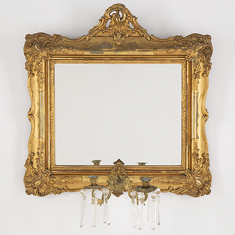A late 19th century mirror sconce.