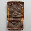 A 1992 monogram canvas garment bag.