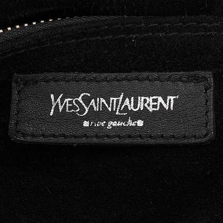 Yves saint laurent, a black leather 'muse' bag.