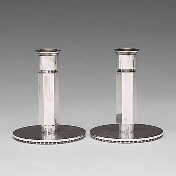 162. Wiwen Nilsson, a pair of sterling candlesticks, Lund, Sweden 1948 and 1956.