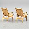 Bruno mathsson, a pair of'eva' easy chairs from  firma karl mathsson, värnamo 1977.