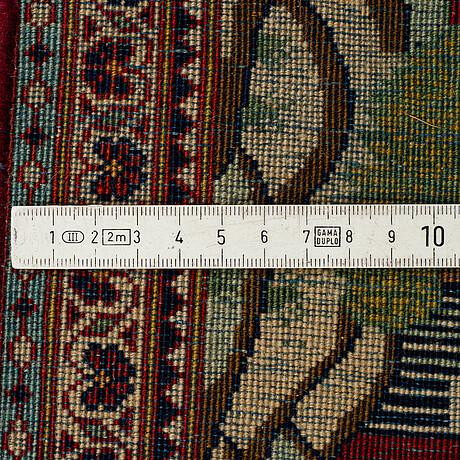 A rug, semi-antique kashan figural 200 x 135 cm.