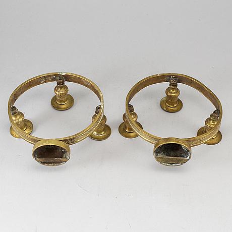 A pair of empire style appliqués.