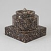 A porphyry stand, 19th century.