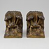 Book ends, patinated metal,  early 20th century.