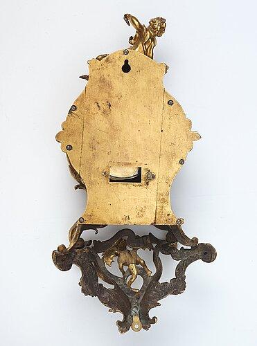 A rococo mid 18th century cartel clock.