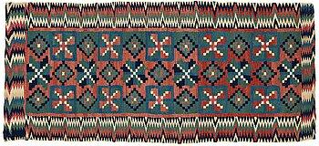 """296. A CARRIAGE CUSHION, double-interlocked tapestry, """"Åttabladsstjärnor"""", ca 46,5 x 104 cm, Scania (Sweden) around 1800."""