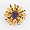 An 18k gold and cabochon-cut amethyst brooch by engelbert.
