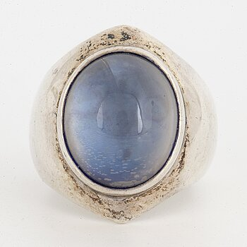 A Rey Urban sterlingsilver ring with cabochon-cut blue stone.