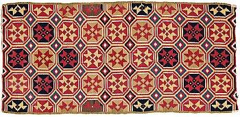"297. A CARRIAGE CUSHION, double-interlocked tapestry, ""Stjärnmönster"", ca 43,5-44,5 x 94-95 cm, Scania (Sweden)."