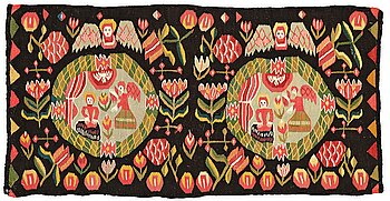 """293. A CARRIAGE CUSHION, tapestry weave, """"the Annunciation"""", ca 47,5-49,5 x 96,5-97,5 cm, Scania (Sweden)."""