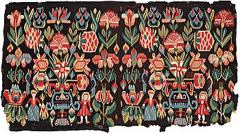"294. A CARRIAGE CUSHION FRAGMENT, tapestry weave, ""Urnor och par"", ca 51-53,5 x 92-97 cm, Scania (Sweden)."