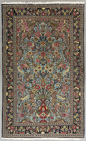 An old ghom carpet ca 243 x 150 cm.
