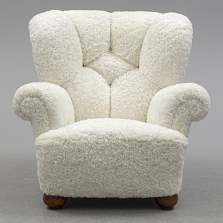 A sheep skin covered swedish modern easy chair, 1940's.