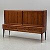 A 1960's rosewood veneered sideboard.