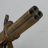A percussion pistol, four barrels, 19th century.